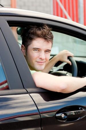Smiling man sitting in his car photo