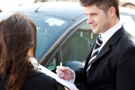 Confident businessman undersign a car contract Stock Photo - 10243379