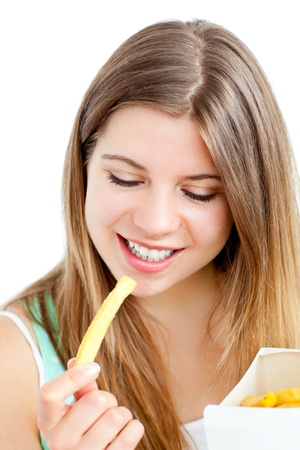 Happy young woman eating fries photo