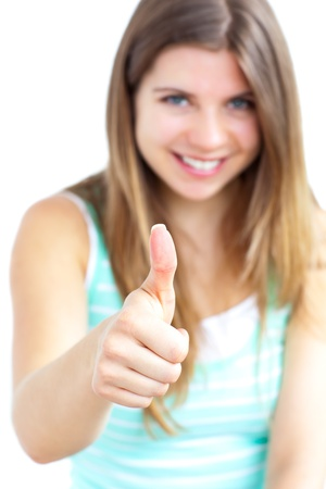 Positive woman with her thumb up to the camera Stock Photo - 10241052