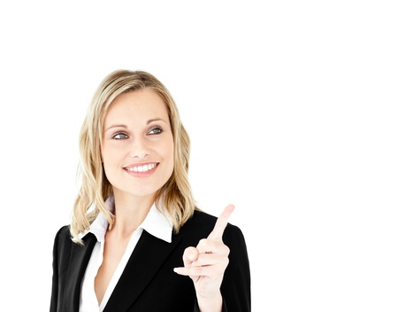 Bright young businesswoman showing a direction with a finger photo