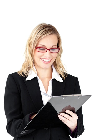 Serious businesswoman wearing glasses taking notes in her clipboard photo