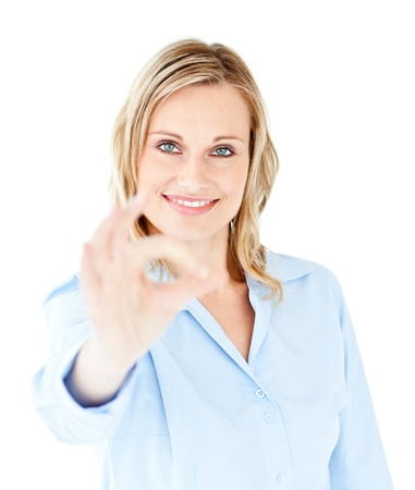 Confident young businesswoman showing OK sign photo