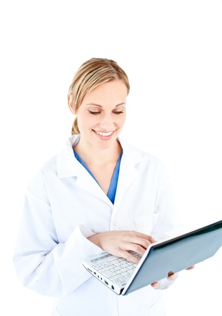 Cute female doctor holding a laptop photo