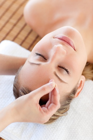 radiant: Relaxed woman receiving an acupuncture treatment Stock Photo