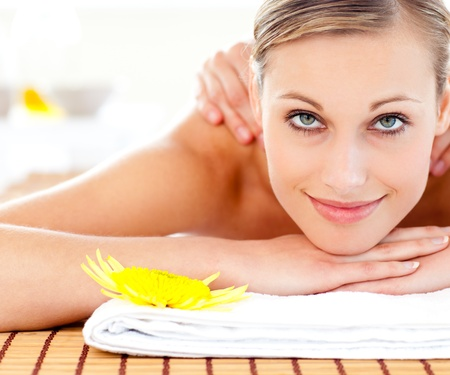 Portrait of a positive young woman receiving a massage Stock Photo - 10240974