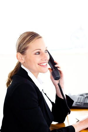 Ambitious businesswoman talking on phone photo