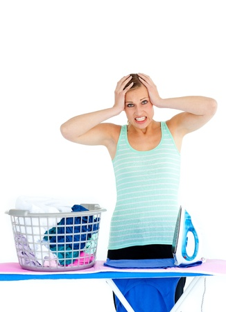 Upset woman ironing photo