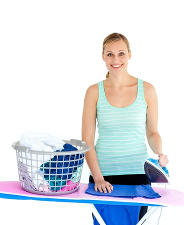 Happy woman ironing photo