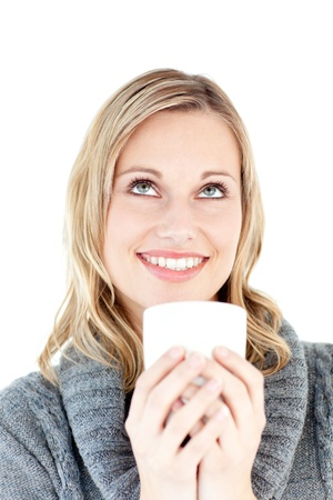 Thoughtful woman enjoying a hot coffee standing photo
