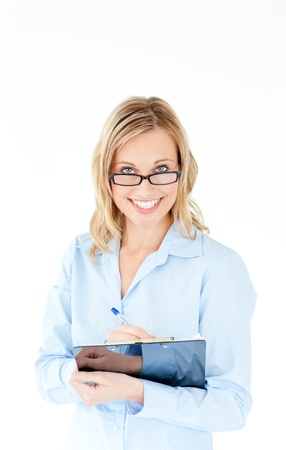 Smiling businesswoman wearing glasses and holding a clipboard photo