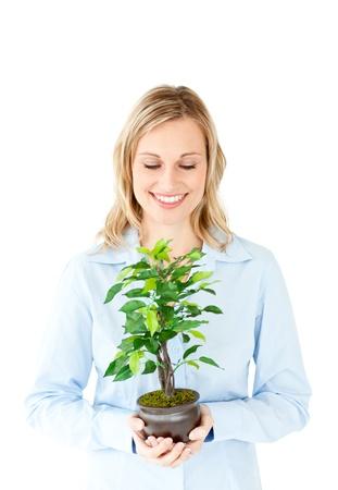 Portrait of a charismatic businesswoman holding a plant photo