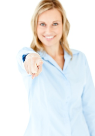Bright young businesswoman showing with a finger at the camera photo