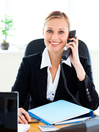 radiant: Radiant businesswoman talking on phone in her office Stock Photo