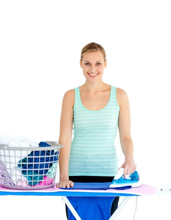 Joyful woman ironing her clothes photo