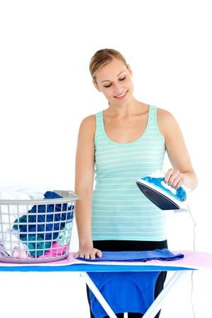 Bright woman ironing her clothes photo