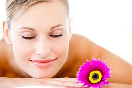 Close-up of a bright woman lying on a massage table with a flower Stock Photo - 10241419