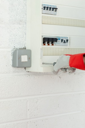 Close-up of a mature electrician repairing a power plan photo