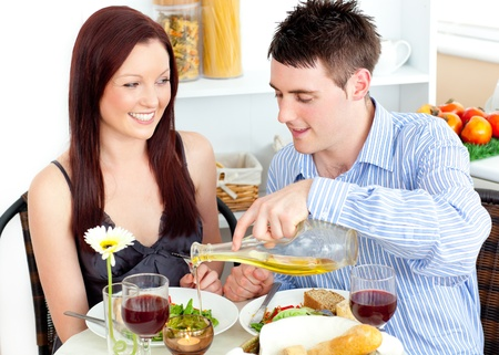 Radiant couple having dinner together in the kitchen Stock Photo - 10243404