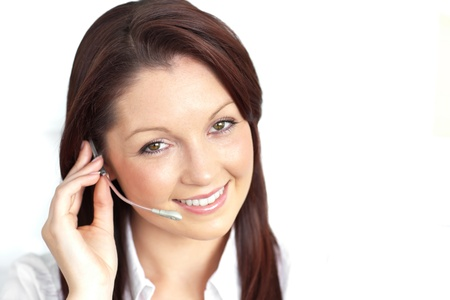 Delighted young businesswoman wearing headphones photo
