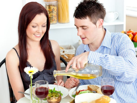 Young couple having dinner in the kitchen Stock Photo - 10242975