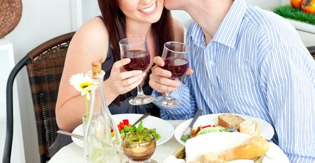 Close-up og a happy boyfriend kissing his beautiful girlfriend during dinner Stock Photo - 10242572