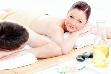 Attractive young couple lying on a massage table Stock Photo - 10241329