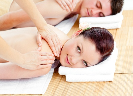 Bright young couple receiving a back massage photo