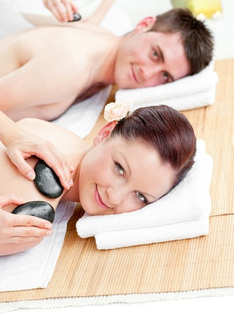 Attractive young couple receiving a back massage with hot stones Stock Photo - 10242581