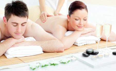 Charming young couple enjoying a back massage photo