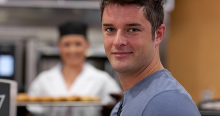 Handsome male customer in a bakery photo