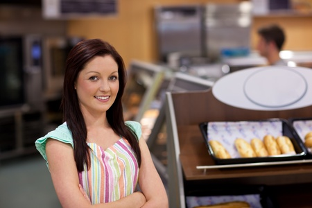Charismatic female cook smiling at the camera photo