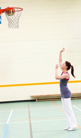 Gifted woman practicing basketball photo