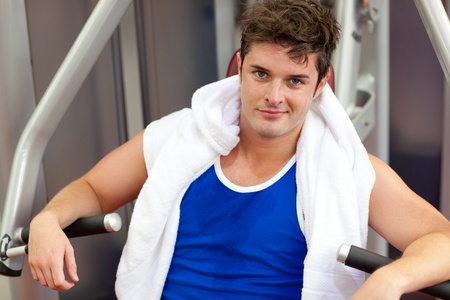 Handsome muscular man using a bench press Stock Photo - 10243152