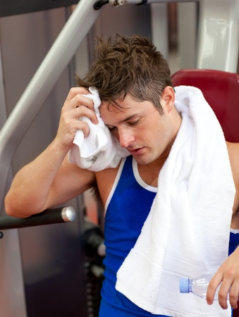 musculation: Tired man using a bench press