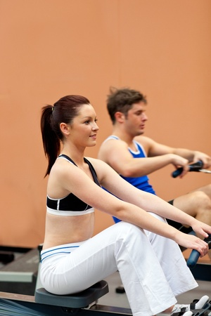 musculation: Athletic people using a rower Stock Photo