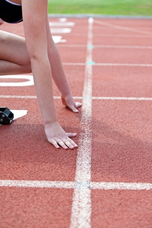 starting line: Close-up of a woman waiting in starting block