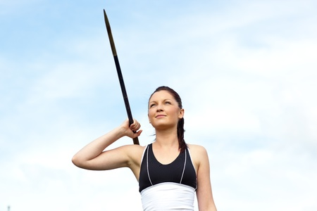 active arrow: Female athlete throwing the javelin Stock Photo