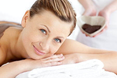 Smiling woman lying on a massage table photo