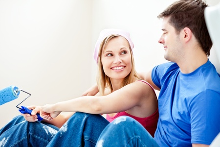 Loving couple painting a room Stock Photo - 10242988