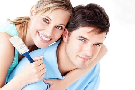 Portrait of a young bright couple painting their new room Stock Photo - 10243372