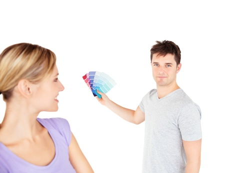 Bright couple choosing color for a room Stock Photo - 10240711