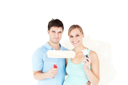 paintrush: Charming caucasian couple painting a room Stock Photo