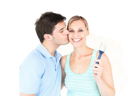 Happy caucasianl couple painting a room Stock Photo
