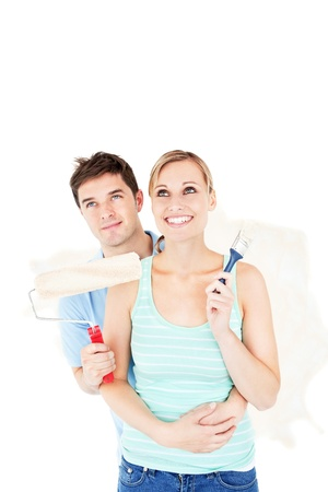 paintrush: Affectionate caucasian couple painting a room Stock Photo