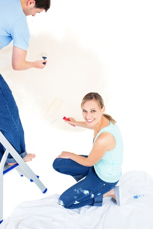 paintrush: Serious caucasian couple painting a room