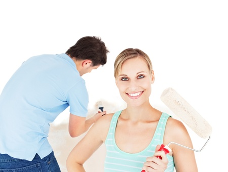 Bright caucasian couple painting a room Stock Photo - 10241125