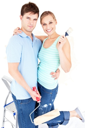 paintrush: Loving caucasian couple painting a room