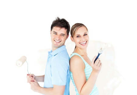 paintrush: Bright young couple painting a room Stock Photo