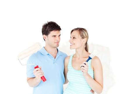 paintrush: Lovely young couple painting a room